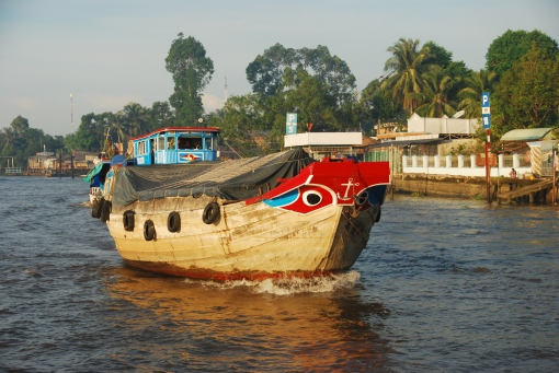 Traditional rice barge with decorative eyes