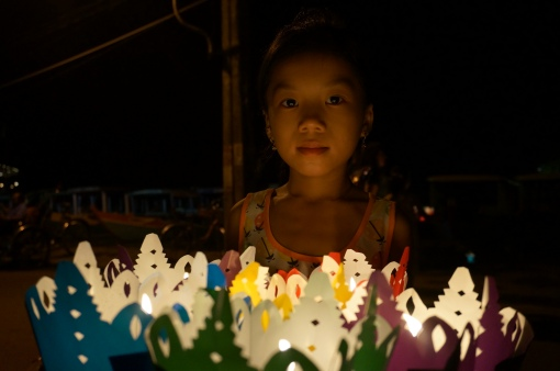 Child selling lanterns at the festival