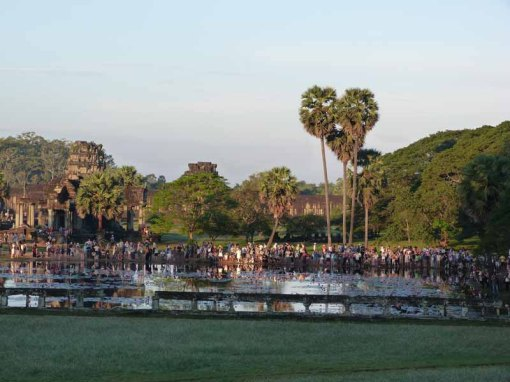 Huge crowds gather to watch the sunrise at Angkor Wat