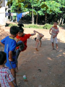 Playing in the street Indochina Encompassed